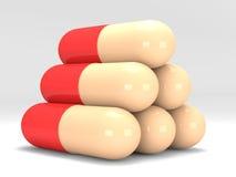 Pirámide de píldoras en el fondo blanco Fotografía de archivo libre de regalías