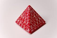 Pirámide roja del juguete Fotos de archivo