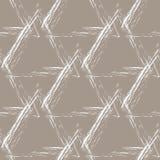 Pirámides blancas del grunge en un fondo beige Foto de archivo libre de regalías