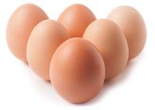 A pirâmide deu forma à pilha do ovo da galinha, isolada no fundo branco Imagem de Stock Royalty Free