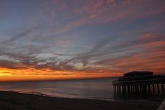 Pir av Scheveningen på solnedgången Fotografering för Bildbyråer