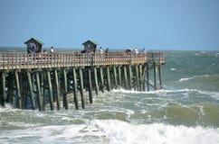 pir för strandfiskeflagler Arkivfoto