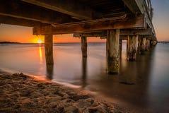 Pir i Frankston, Victoria, Australien på solnedgången i sommaren Arkivbild