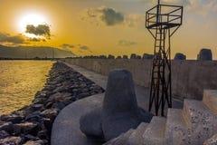 Pir på en solnedgång Royaltyfri Bild