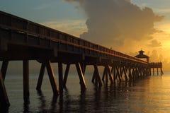 Pir på soluppgången Arkivbilder