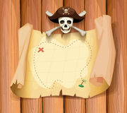 Piraatschedel en een kaart op de muur Stock Afbeeldingen