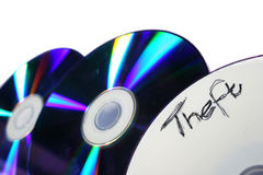 Piracy. Blank DVD's and the word theft on one of them Stock Images
