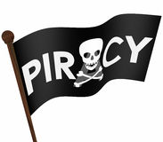 Piracy Flag Illegal Downloading Files Internet Sharing Sites. Piracy word and skull and crossbones on a black flag illegal file sharing on internet torrent Stock Photo
