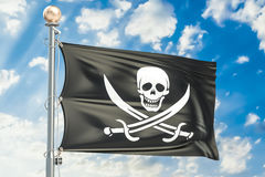Piracy flag waving in blue cloudy sky, 3D rendering Royalty Free Stock Images