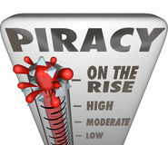 Piracy On the Rise Thermometer Measuring Illegal File Sharing Do. Piracy On the Rise words on a thermometer measuring illegal file sharing on internet torrent Royalty Free Stock Images