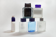 Piramid of empty bottles of lotions and gels after shave Royalty Free Stock Photo