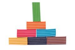 Piramide van plasticine op een geïsoleerde achtergrond Stock Foto's