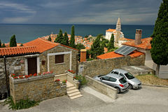 Piran and Cathedral of St. George. Traditional house above the town of Piran and Cathedral of St. George Royalty Free Stock Images