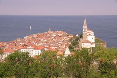 Piran city and cathedral. High angle view or Piran city with cathedral of St George, sea in background, Slovenia Stock Photography