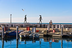 Piran harbor with symbolic statues of Tartini theatre, Istria Royalty Free Stock Image
