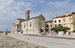 Piran lighthouse and St. Clement and Punta Madonna church in Slovenia Royalty Free Stock Image