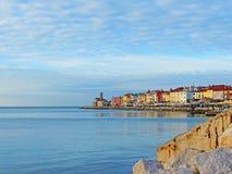 A Scenic View of Piran Coastline in Slovenia. Clear blue sky and the colourful Pirans coastline in Slovenia Royalty Free Stock Photo