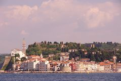 Piran, Slovenia. Withe the saint George cathedral and the old city walls at the hill Stock Image