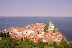Piran, Slovenia. Withe the saint George cathedral from the old city walls at the hill Royalty Free Stock Images
