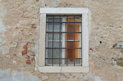 Piran, Slovenia -- old window. Old window shows signs of fatigue against the sun and the Adriatic sea Stock Images