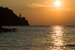 Piran, Slovenia. Sunset over sea near Piran, Slovenia Stock Photo