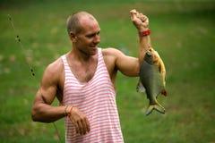 Piranha da pesca do homem Imagem de Stock