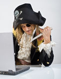 Pirat computer. Pirate attacking with a knife a laptop computer Royalty Free Stock Image