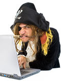 Pirat computer. Pirate attacking with a knife a laptop computer Royalty Free Stock Photo