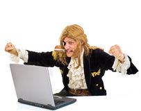 Pirat computer. Pirate attacking with a knife a laptop computer Stock Photography