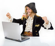 Pirat computer. Pirate attacking with a knife a laptop computer Stock Images