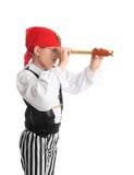 Pirat, der unter Verwendung eines Aufdeckungbereichs sucht Stockbilder