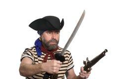 Pirata com um mosquete e uma espada Fotos de Stock
