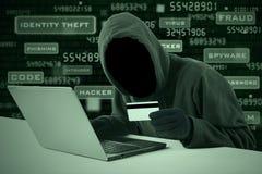Pirata informático que roba el número de tarjeta de crédito Fotos de archivo