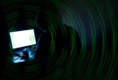 Pirata informatico anonimo del criminale di computer Fotografie Stock