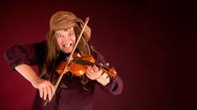 Pirata que joga o violino para anunciar algo Foto de Stock Royalty Free