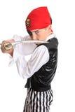 Pirata que sostiene una espada del machete Fotos de archivo libres de regalías
