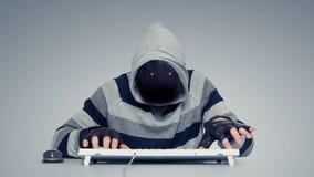 Piratas informáticos anónimos en el ordenador Imagenes de archivo