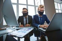 Piratas informáticos del negocio Imagen de archivo