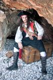 Pirate. Siting on treasure trunk Royalty Free Stock Image
