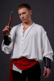 Pirate. Male model posing in pirate clothes with a Flintlock pistol Royalty Free Stock Images