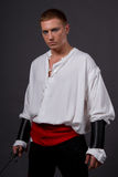 Pirate. Male model posing in pirate clothes with a sword Royalty Free Stock Photography