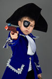 The  pirate. The boy in a suit of the pirate, aims from a gun Royalty Free Stock Image