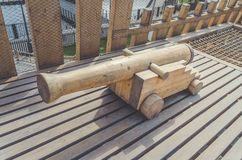Pirate artillery cannon out of wood. Ancient pirate artillery gun made of wood royalty free stock image