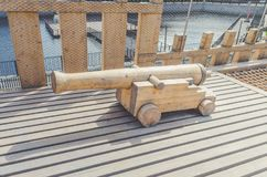 Pirate artillery cannon out of wood. Ancient pirate artillery gun made of wood stock photography
