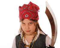 Pirate with Attitude. Closeup portrait of an elementary girl with attitude dressed as a pirate and weilding a sword. Isolated on white royalty free stock photo