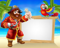 Pirate beach sign. Fun cartoon pirate beach sign illustration of a fun cartoon pirate on a beach holding a treasure map with his parrot on the sign and palm Stock Photography