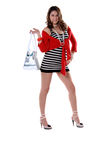 Pirate Booty. Pretty young Mexican woman in a red top, black and white striped mini dress and white leather handbag over her shoulder Stock Photo