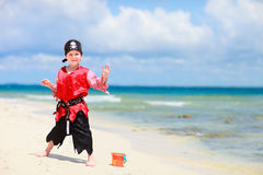 Pirate boy on tropical beach Royalty Free Stock Photography