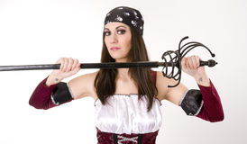 Female Pirate Captain Pulls Sword From Sheath Royalty Free Stock Images
