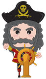 pirate captain standing next too ship wheel Stock Images